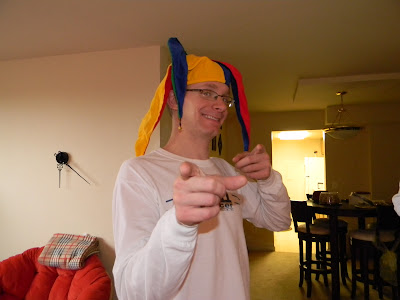 me in a jester cap, smiling stupidly.