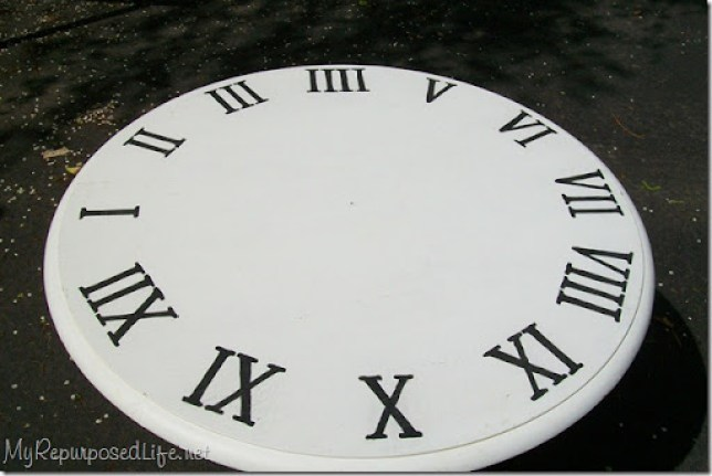 stenciled extra large clock made from an old kitchen table
