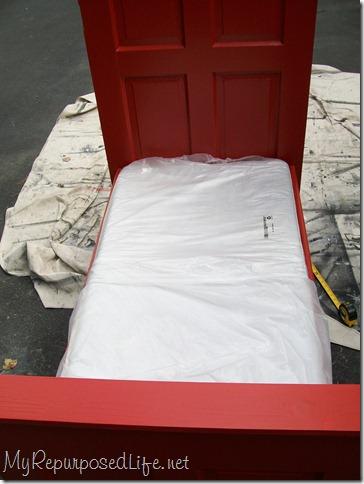 door repurposed into toddler bed