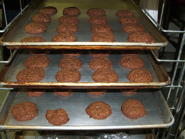 awaiting their white chocolate drizzle...I need a baking rack like this, yes?