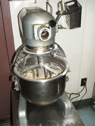 This mixer is currently cranking out a quadruple batch of Eggnog Log dough with the easy of melted butter...I need one of these too!