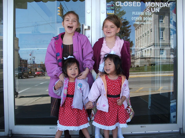 The girls in front of my parents restaurant Easter Sunday.
