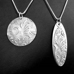 Two Pendants with Plume Design