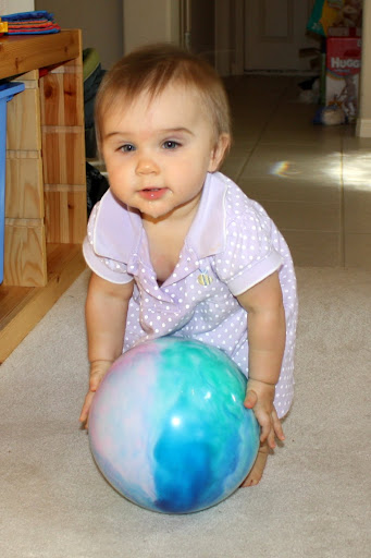 Kyra picks up the ball at 11 months