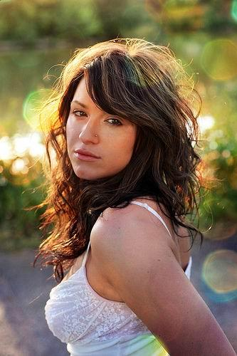 Long layered wavy curly hair with bangs. This brunette layered cuts with