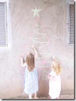 Allie and Beth draw tree on wall