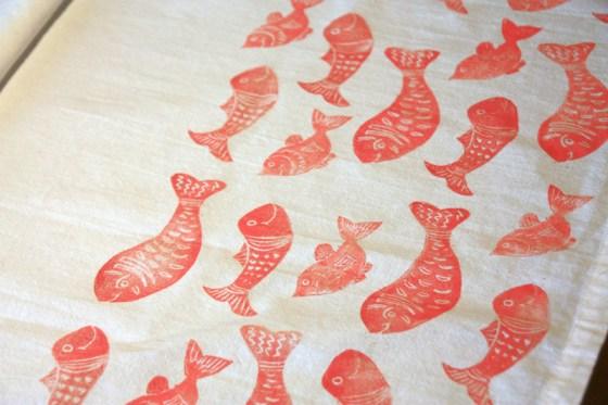 Fish block printed on tea towels joyful roots