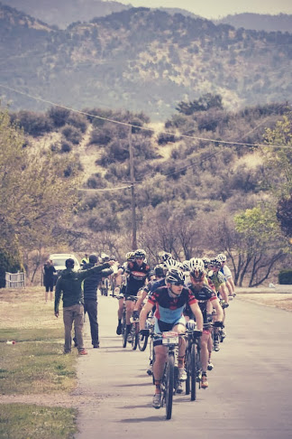 The feed zone was chaos. 40 people trying to grab bottles without slowing down. I went to the front to stay safe.