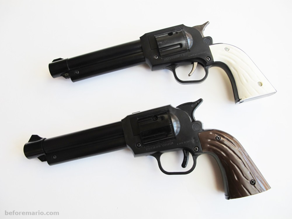 medium resolution of the k senj sp gun has a white handle and a metal trigger and hammer