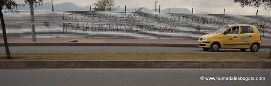 Grafitti sobre el perímetro del Humedal El Burrito