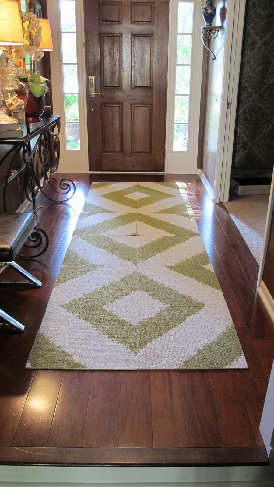 5 simple flooring fixes for homeowners and renters furnishmyway blog flooring fixes green and white geometric patterned carpet in entryway with wood floors dailygadgetfo Gallery