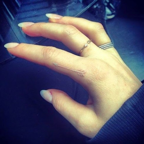 white ink index finger tattoos