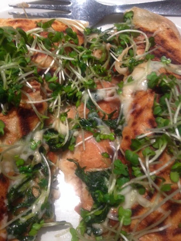 Hot vegetable crepe filled with cheese and topped with cress