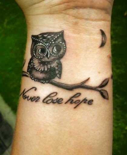 quirky Owl tattoos on wrist