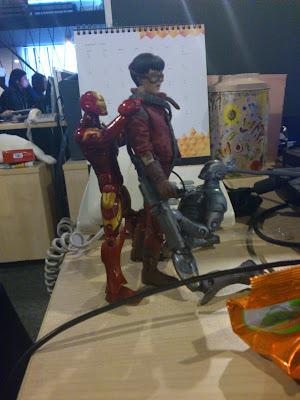 Warmachine and Iron Man massaging Akira