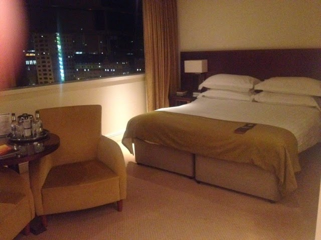 The bed and chair at the Macdonald Manchester Hotel