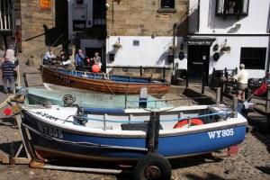 Boats in Robin Hoods Bay and Wainwrights Bar