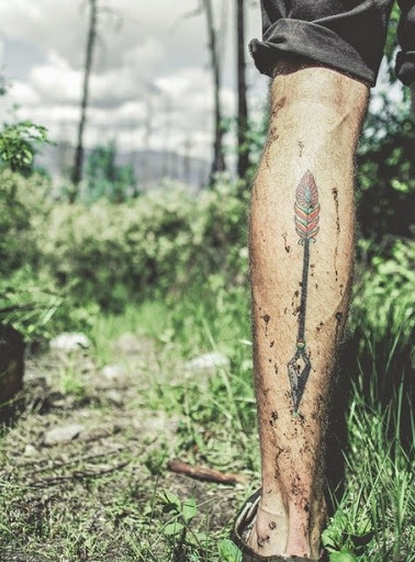 Arrow tattoos on leg