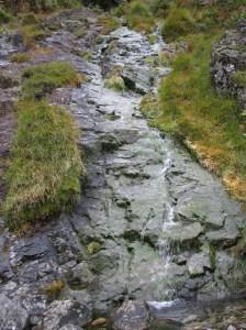 Water slips down the rocks