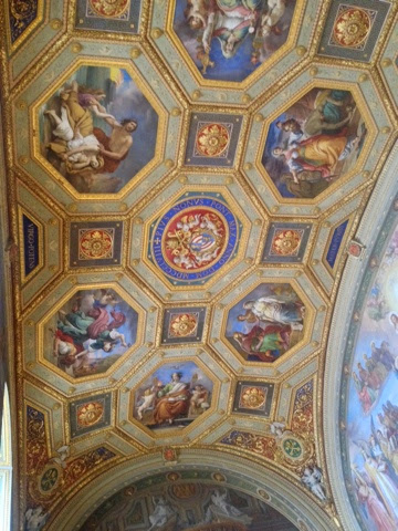 Gold-framed paintings decorating the Vatican