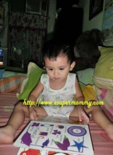 Filipino Toddler reading a book