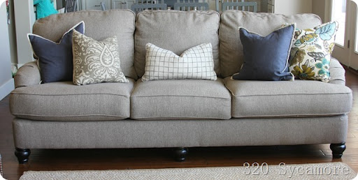 ashley hariston sofa review cleaning multiyork covers 3 decorating truths in any home 320 sycamore neutral with colorful pillows