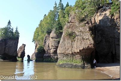 Kay at water's edge at high tide, Hopewell Rocks, Bay of Fundy, New Brunswick