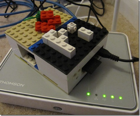 Raspberry Pi in Lego case connected to a router
