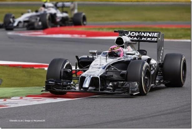 Jenson Button leads Kevin Magnussen.