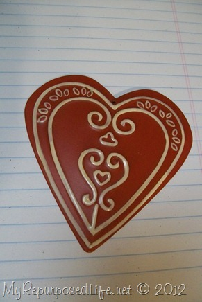 red metal heart with flourishes