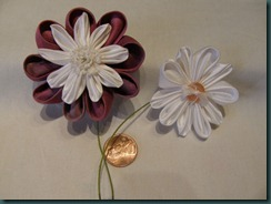 Two flower with stems