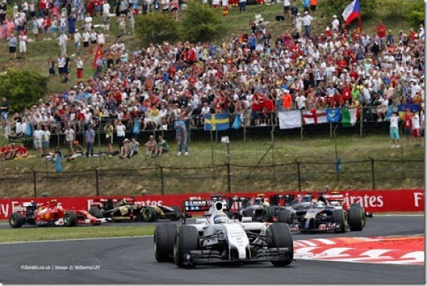 Hungaroring, Budapest, Hungary.Sunday 27 July 2014.Felipe Massa, Williams FW36 Mercedes, leads Jean-Eric Vergne, Toro Rosso STR9 Renault, and the remainder of the field at the start.World Copyright: Alastair Staley/Williams F1.ref: Digital Image _79P7184
