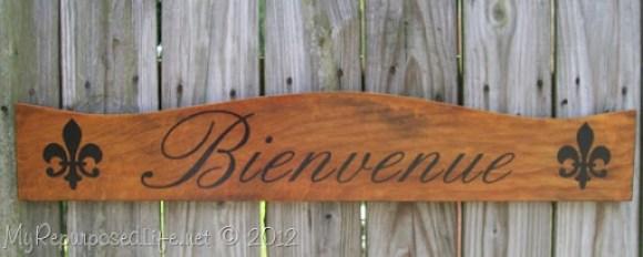 Bienvenue sign repurposed headboard