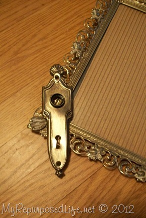 ornate frame and shiny antique door plate