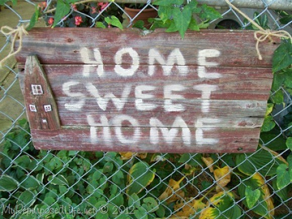 stockade fence repurposed into rustic sign