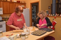 Sue and Deb concentrating on pumpkin tartlets