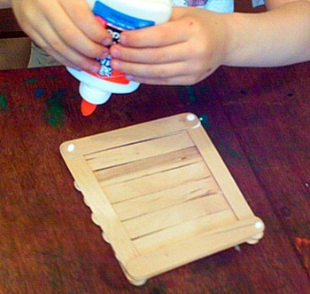 Glue each of the corners and stack up the craft sticks