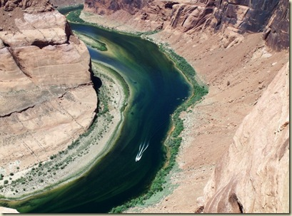 Boat on Colorado River at Horseshoe Bend Page Arizona
