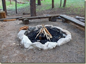 Campfire ready to light at campground amphitheater North Rim Grand Canyon National Park Arizona