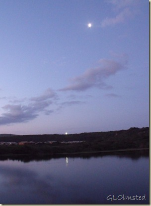 Sunset, moon & lit cross reflected in river Riviera Hartenbos Garden Route Western Cape South Africa