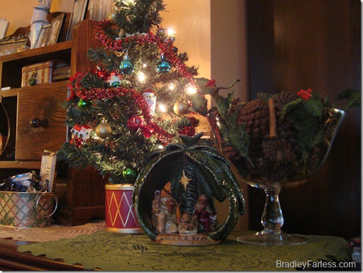 A little tree and nativity scene on the dresser.