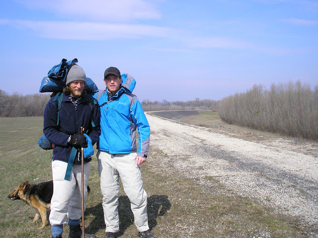 This is me and Eric triumphantly crossing the border into Hungary. Notice the wind.