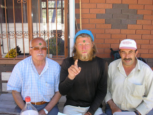 The man on the left gave me a meal which included cucumber. Not wishing to waste the end bits, he made little horns for us both.
