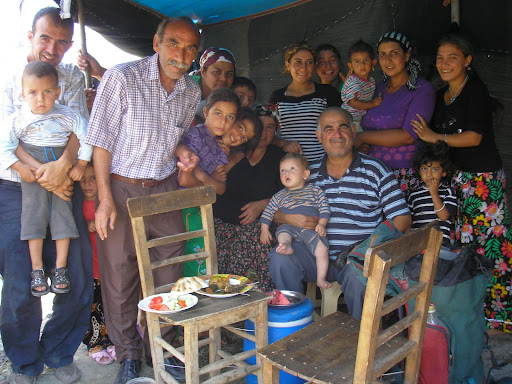 A big family who have moved into a tent for the summer to escape from the insane heat in their home town of Adana. On the chair is the meal they watched me eat including a fish of some nature, freshly caught.