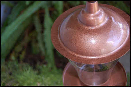 Hammered copper spray paint gave this bird feeder a new life! Super easy to do too!