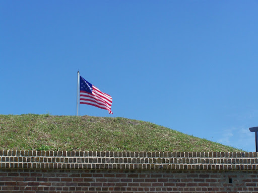 The Star Spangled Banner (15 stripes and stars) flies above Fort Moultrie.
