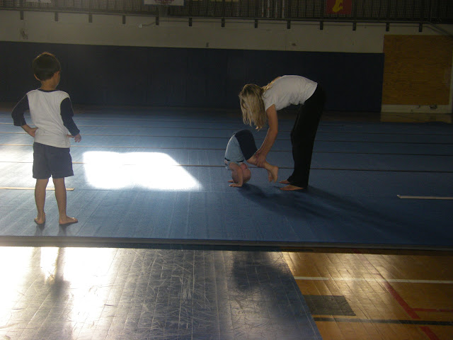 Getting help with a somersault.