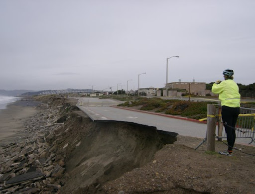 Bicyclist examines Ocean Beach erosion