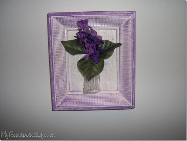 purple frame old bottle purple flowers