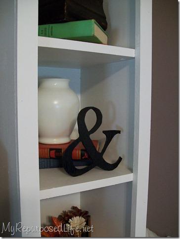 bookshelf with ampersand
